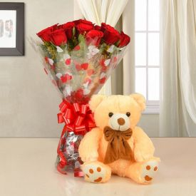 A vase of 30 mixed roses, and pink (12-inch) teddy bear