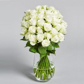 white roses with vase