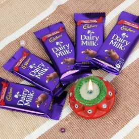 Sweets With Diya and Greeting Card