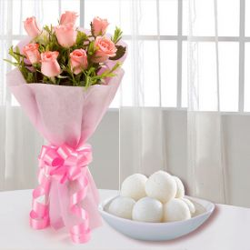 A bunch of lovely 12 pink roses with 1 kg Rasgulla from Haldiram.