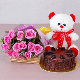 A bunch of 20 pink, or yellow roses, 1 kg fruit cake and 6 inch teddy.