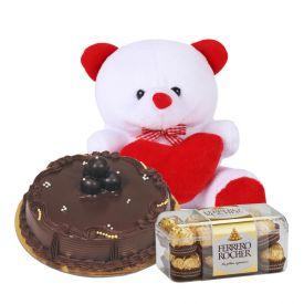 1kg chocolate cake, 6 inch teddy bear and12 ferrero rochers.