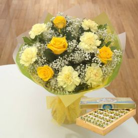 Yellow and White carnation and Mixed Sweets