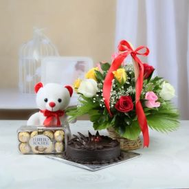 Red roses, chocolate cake, ferrero Rocher with teddy