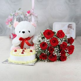 A bunch of 20 pink roses 1 kg pineapple cake and white 12- inch- teddy .