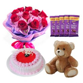 Red Roses, Strawberry cake, teddy bear with dairy milk