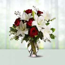lilies and roses with vase