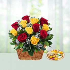 Basket of mixed roses with sweets