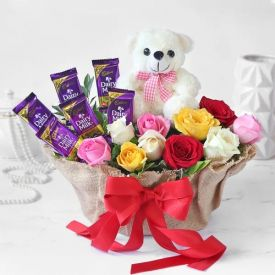 Bunch of 10 mixed Carnation, chocolates and Teddy
