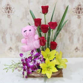 Mixed Flowers With teddy bear.