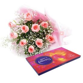 Pink roses with cadbury celebration