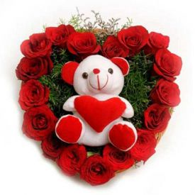 A heart shaped 50 red roses with cute teddy bear