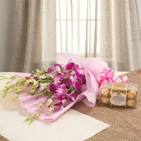 purple orchids with chocolates