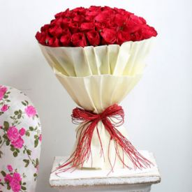 Bunch of 30 red roses with paper packing